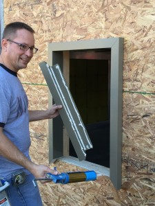 John Brooks, President of BRINC, BP Inc. demonstrating how to install ThermalBuck into a rough opening for a window installation - contact page